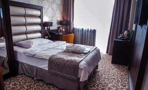Postel nebo postele na pokoji v ubytování Hotel Kaskady