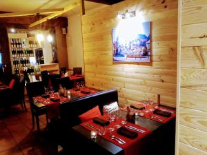 A restaurant or other place to eat at Hotel Colmar Vignes Eguisheim