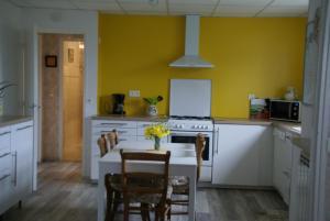 A kitchen or kitchenette at Gîte Mille Fleurs