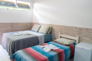 Cama ou camas em um quarto em Pousada Recanto Rubaiyat