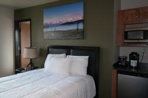A bed or beds in a room at Sitka Hotel