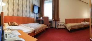 Кровать или кровати в номере Hotel Geyer