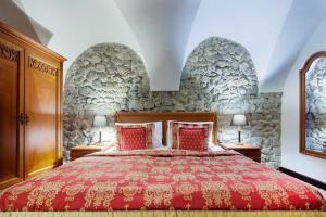 Ein Bett oder Betten in einem Zimmer der Unterkunft Arcadia Boutique Hotel