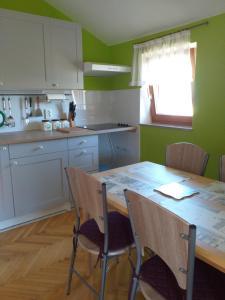 A kitchen or kitchenette at Apartments Ivanković