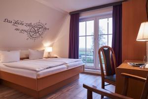 Ein Bett oder Betten in einem Zimmer der Unterkunft Landhaus Großes Meer