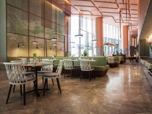 A restaurant or other place to eat at Oasia Hotel Downtown, Singapore by Far East Hospitality (SG Clean)