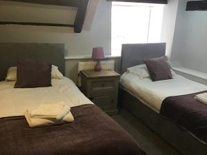 A bed or beds in a room at Anglebury House