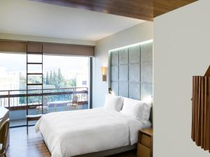 A bed or beds in a room at New Hotel