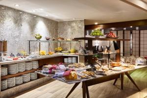 Um restaurante ou outro lugar para comer em Sheraton Porto Alegre