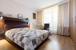 Кровать или кровати в номере Семейные апартаменты