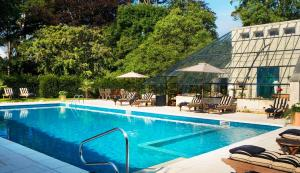 The swimming pool at or near Chateau La Cheneviere