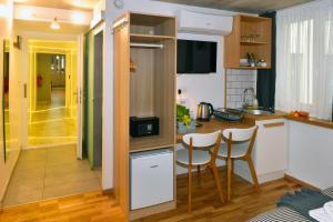 A kitchen or kitchenette at Walk Inn Váci 78