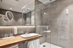 Ein Badezimmer in der Unterkunft H+ Hotel Bremen