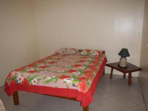 Cama ou camas em um quarto em HUAHINE - Fare Hautiare