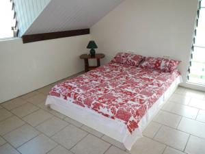 Cama ou camas em um quarto em HUAHINE - Villa Tiare Tipanier (Tiarenui et Iti)