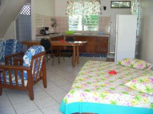 A cozinha ou cozinha compacta de HUAHINE - Fare Tiareiti