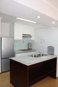 A kitchen or kitchenette at Saigon Sky Garden Serviced Apartments