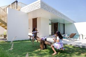 A family staying at The Private Pool Villas at Civilai Hill Khao Yai