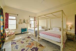 A bed or beds in a room at Bujera Fort