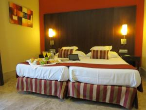 A bed or beds in a room at Hotel Boutique Atrio