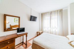 Cama o camas de una habitación en Hotel Sevilla
