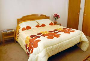 Кровать или кровати в номере Hotel Libertador Bernardo O´Higgins
