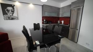 Kuchnia lub aneks kuchenny w obiekcie Apartament Delux