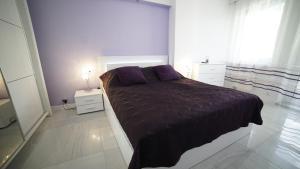 Łóżko lub łóżka w pokoju w obiekcie Apartament Delux