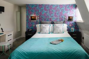 A bed or beds in a room at Harington's Hotel