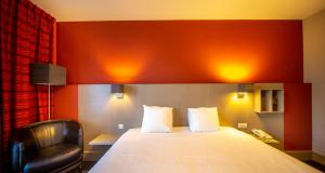 A bed or beds in a room at Hotel Pantheon Palace by WP Hotels