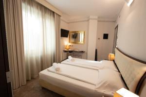 Letto o letti in una camera di Hotel Corona