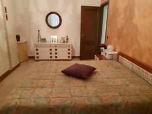 A bed or beds in a room at A Casa di Anto e Dani