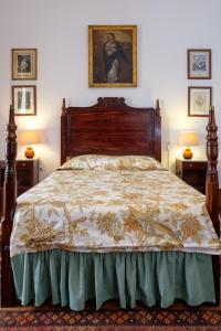 A bed or beds in a room at Casa De Borba