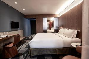 A bed or beds in a room at AthensWas Design Hotel