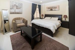 Cama ou camas em um quarto em Shamsoon Suits