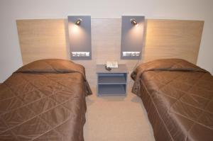 Ένα ή περισσότερα κρεβάτια σε δωμάτιο στο Achillio Hotel