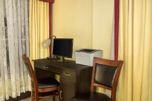 A television and/or entertainment center at Days Inn by Wyndham Florida City