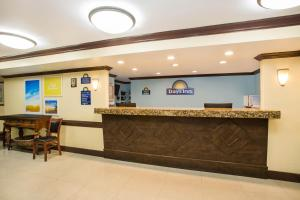 The lobby or reception area at Days Inn by Wyndham Florida City