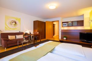 A bed or beds in a room at ACANTUS Hotel