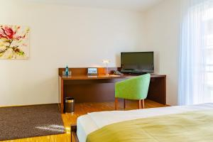 A television and/or entertainment center at ACANTUS Hotel