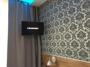 Telewizja i/lub zestaw kina domowego w obiekcie A&P Motel
