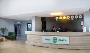 Лобби или стойка регистрации в ORBI Residence and Plaza first line from the sea