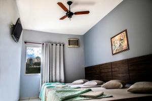 Cama ou camas em um quarto em Hotel Faenician