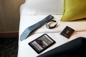 Letto o letti in una camera di Abu Dhabi Airport Hotel T3 Arrivals