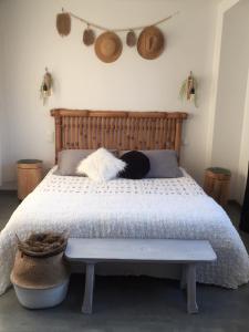 A bed or beds in a room at B&B La Laiterie de Fontpatour