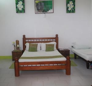 A bed or beds in a room at Coco Bay Villa