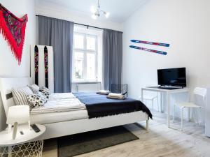 Łóżko lub łóżka w pokoju w obiekcie Noc w Krakowie Apartamenty