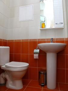 A bathroom at Nevsky 126 Guest House