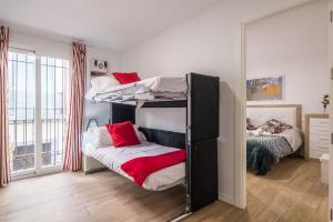 Een stapelbed of stapelbedden in een kamer bij Apartamento San Isidro, OZONO