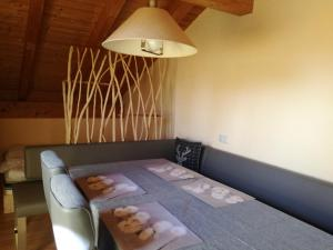 """A bed or beds in a room at FeWo """"Sonnenschein"""" Oberreute"""